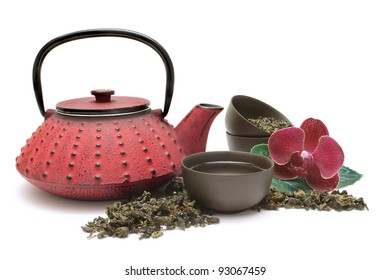 Chinese Oolong green tea with small pot and cups isolated on white