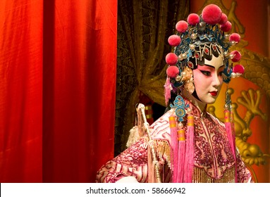 chinese opera dummy and red cloth as text space ,it is a toy,not real man