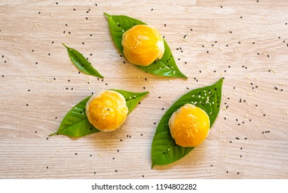 Chinese pastry or Traditional Thai cake with leaf on table background top down view