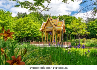 Chinese pavilion with buddha statue in Munich public westpark, Bavaria travel