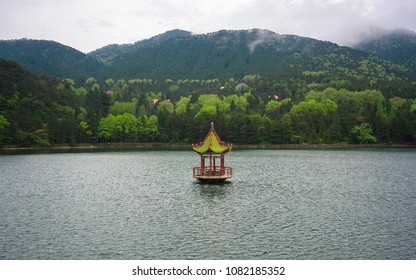 Chinese pavilion in middle of Lulin lake in mount Lushan national park Jiangxi China
