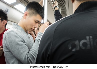 Chinese People Taking a Nap Standing up on the Subway in Xi'an, China, March 2018