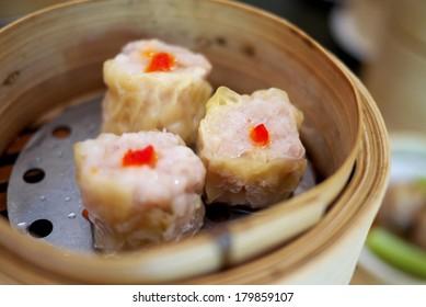 Chinese pork steamed dumplings in bamboo steamer