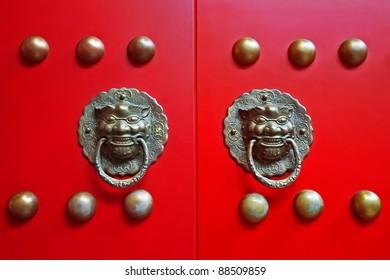 Chinese red gate doors with lion door knob, Forbidden City , Beijing