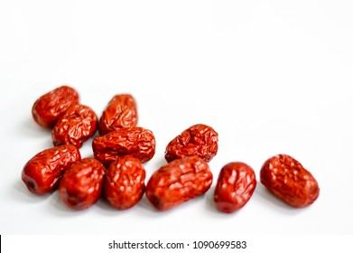 Chinese Red Jujube Isolated on White Background. Jujube is also called Chinese date and often used as traditional Chinese medicine. Copy Space at Top.