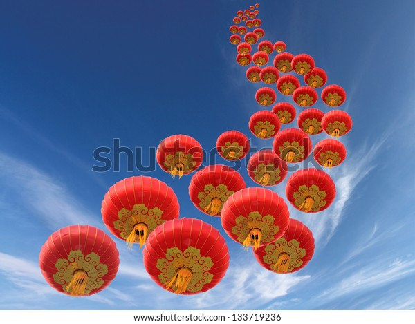 Chinese red paper lanterns and sky as background