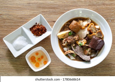 Chinese roll noodle soup with crispy pork, Thai language called *Kuay Jab* and seasoning Chinese food / Select focus space for text