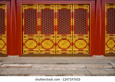 Chinese royal doors in the Forbidden City in Beijing, China