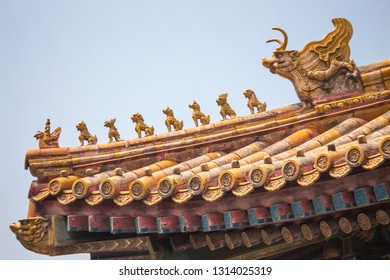 Chinese sculptures - qilins, on the roof close up.