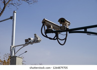 Chinese security video cameras on a street in Beijing