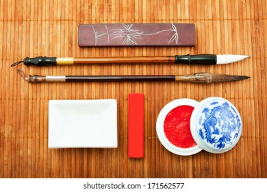 the Chinese set for calligraphy, the art of calligraphy, brush for Chinese painting, bamboo brush, Chinese ink, goods for calligraphy