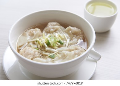 Chinese shrimp dumplings soup with a cup of tea