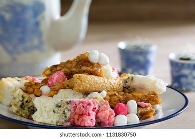 Chinese snack and Chinese tea on old brown wooden table  / Still Life imge and select focus