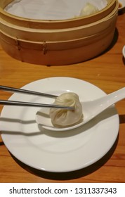 Chinese steamed steamed bun (baozi) named Xiaolongbao also called a soup dumpling. It is traditionally prepared in xiolong small bamboo steaming basket.
