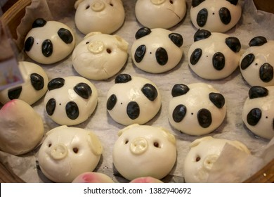 Chinese steamed buns or mantou made in the form of animals- pandas and pigs
