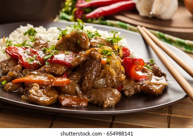 Chinese sticky pork sirloin roasted with a sweet and savory sauce served with boiled rice