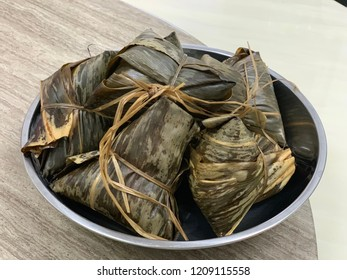 """Chinese sticky rice dumpling or known as """"bak zhang"""", wrapped with lotus leaves."""