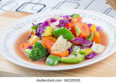Chinese stir fried vegetables in white dish