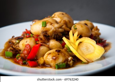 Chinese stir-fried baby squid with black bean sauce