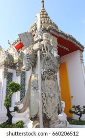 Chinese stone dolls ,the temple gate guardians ,Wat Pho ,Bangkok ,Thailand.