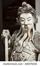 Chinese stone guardian statue close up in Wat Pho Buddhist Temple , Bangkok, Thailand