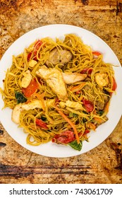 Chinese Style Asian Spicy Singapore Noodles On A Distressed Oven or Baking Tray With Copy Space