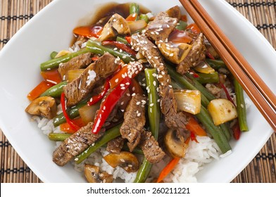 Chinese style beef and green bean stir-fry on white rice.