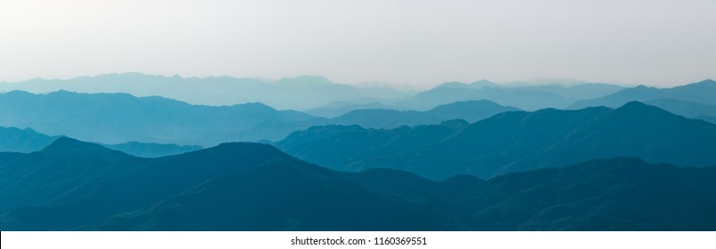 Chinese style blue and black mountains. Rolling hills