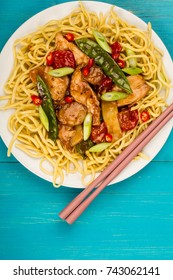 Chinese Style Chicken and Cashew Nuts Stir Fry Meal On A Blue Wooden Background
