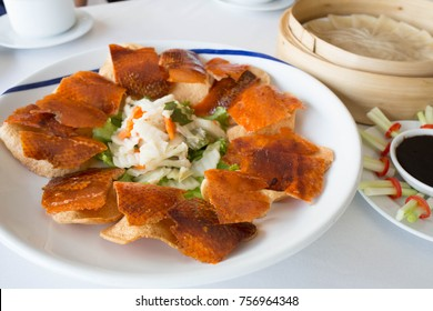 Chinese style crispy duck skin (Beijing Duck) serve with shrimp cracker, pickled vegetable.