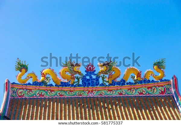Chinese style dragon statue on blue sky background.