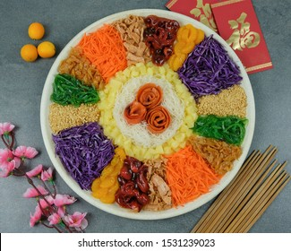 """Chinese style raw fish salad / Lo Hei aka Prosperity Toss / Smoked salmon, colorful vegetable slices, baby octopus, jellyfish, ground peanuts with sweet sour spicy dressing. Chinese word is """"fortune"""""""