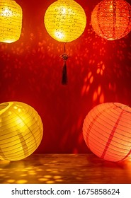 Chinese style retro colored flower lanterns and Ruyi knots hanging on a red background