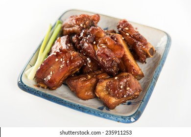 Chinese Sweet and Sour Pork Ribs on White Background