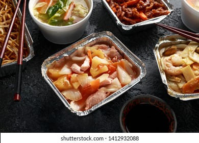 Chinese takeaway food. Pork Wonton dumpling soup, Crispy shredded beef, sweet and sour pineapple chicken, egg noodles with bean sprouts, curry.