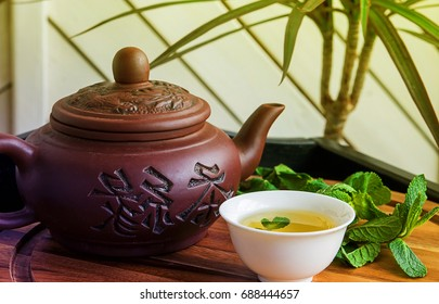 Chinese tea ceremony green tea traditional clay teapot with Chinese characters meaning tea / tea ceremony