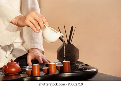 Chinese tea ceremony is perfomed by tea master in kimono