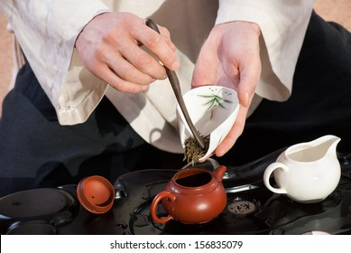 Chinese tea ceremony is performed by tea master in kimono