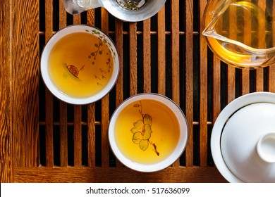 Chinese tea ceremony, shen puer tea, transparent glass, Pialats, tea set on a wooden table. Close up, top view concept