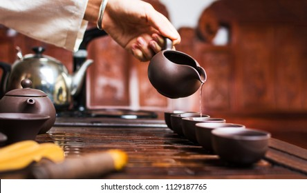 Chinese tea ceremony, Woman pouring traditionally prepared tea