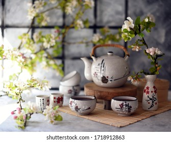 Chinese tea with fresh cherry blossoms. Japanese tea ceremony.  Traditional chinese tea ceremony. Teapot and cups on  table. Asia style stil life.