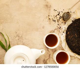 Chinese tea. Pu erh Puerh Tea Cake, top view, copy space