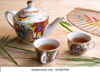 Chinese teapot and teacup on wooden table
