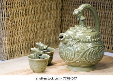 Chinese teapot and two green dragon greedy cups - take too much, learn your lesson.