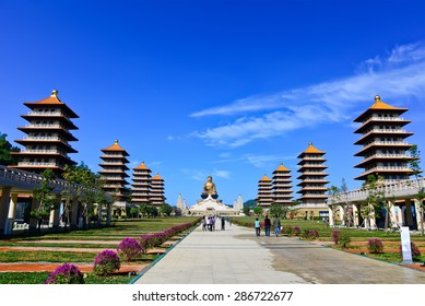 Chinese temple and golden Buddha statue in Kaohsiung, Taiwan.