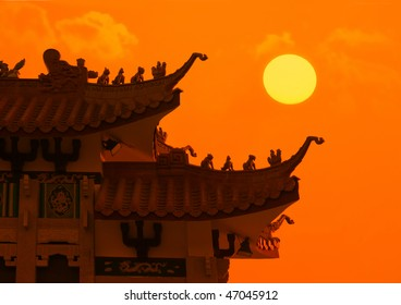 chinese temple roof with sunset