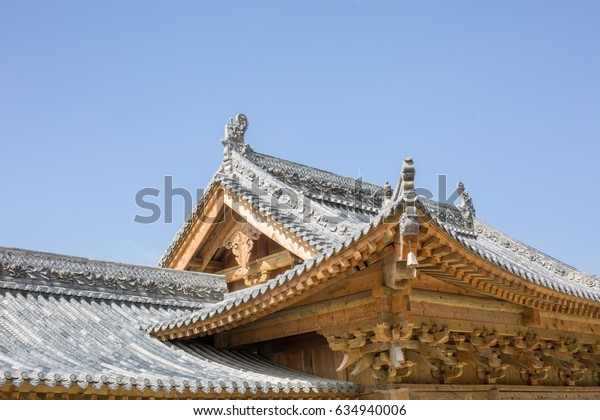 Chinese traditional architectural art,Beautifully carved wooden eaves and blue sky