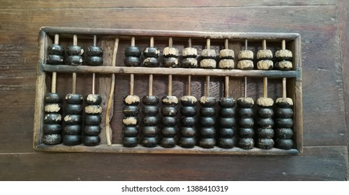 Chinese traditional calculator, old abacus on wooden table - Image