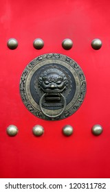Chinese traditional door with brass lion knob - symbol of luck and prosperity