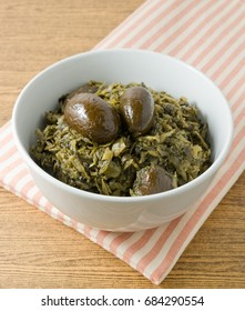Chinese Traditional Food, Delicious Chopped Pickled Green Cabbage with Chinese Olives in A Bowl.